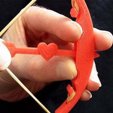 bow arrow - shoot arrow valentines day heart arrow up 5 metres game mechanical toys valentines valentine toy target rubberband rubber romatic romance ring love holiday fun fashion day cupids cupid bracelet bow arrow bow band arrow aim accessory
