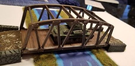 steel girder style sectional bridge system 28mm gaming - wargaming3d 28mm miniature bridges make great objectives bolt action scenarios designed file represent generic steel girder bridge did so sectional system potentially allow any length crossing you may want single span measure approx 8 plus length access ramps file designed fdm printing access ramps have two options one flat edge butt against any straight edge road piece one elongated s mates road system created have available free down load https wwwwargaming3dcom product interlocking-wargaming-road-system  please sure use ramps appropriate road system you using bridge friction fits into ramp well optional centre section which can placed water has 2mm thick base which cna used left off have centre support level whatever material you use represent water surface longest piece bridge's side main frame which exactly 200 mm long should fit most fdm printers bridge surface pieces two per span do not have glued its your choice you can leave fit then remove represent blown surface bridge example